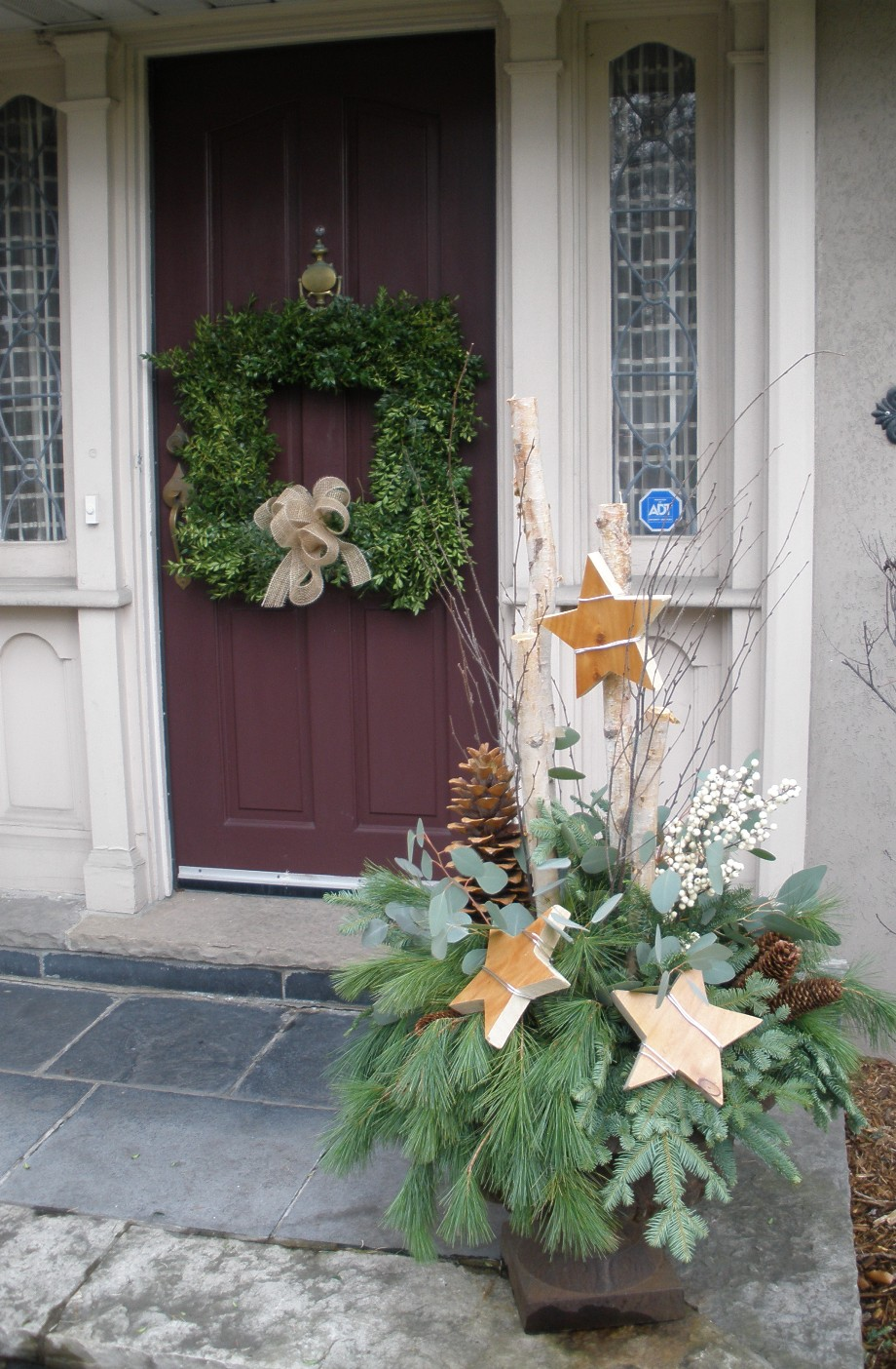 Outdoor Christmas Urns http://martinflowers.com/blog/2009/12/urn-arrangements-outdoors/