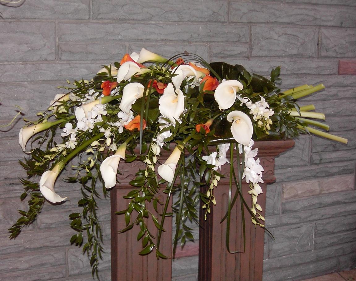 Calla lilies in an elegant casket arrangement
