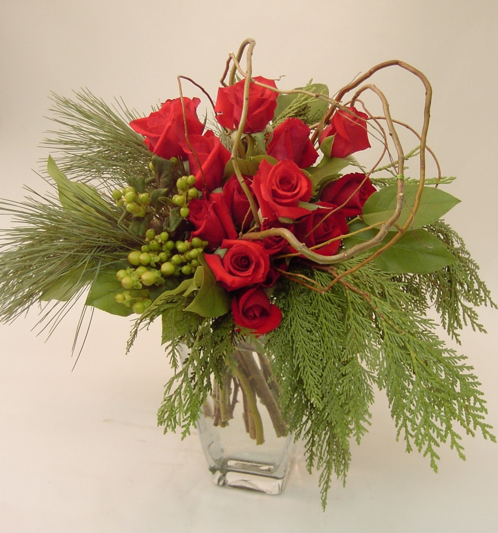 Design of 14 red roses with berries, branches and greens