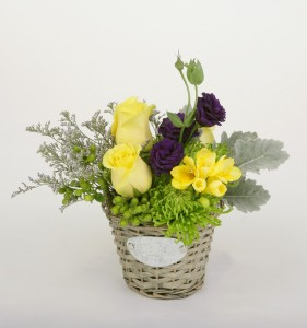 Small basket arrangement in yellow, purple and green