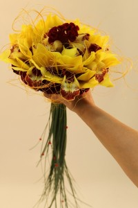 Round Bride's bouquet of orchids and celosia