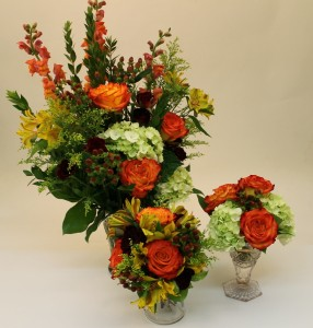 One bouquet  and two arrangements in bright fall tones