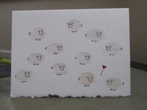 Flock of sheep, two in love