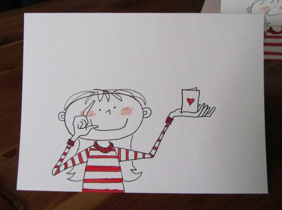 Girl giving a Valentine card