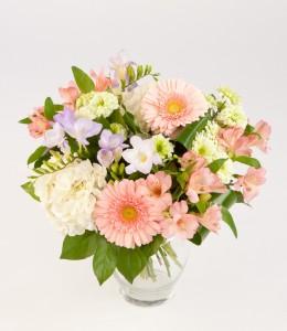 Creamsicle colours in a pretty vase arrangement