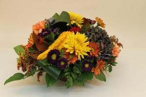 Mums, asters, carnations in fall arrangement