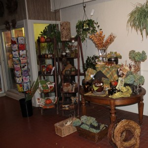 Autumn candles, napkins, bowls and gifts on display