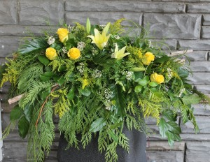 Yellow roses, lilies, birch branches