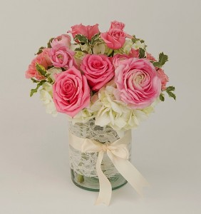Pink and white vase arrangement with ranunculus and roses