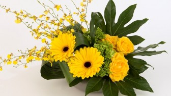 Yellow roses, gerbera and orchids in a stylish design