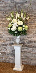 Tall vase of white flowers