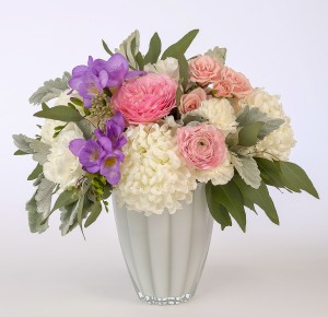 Pink, mauve and white design in a white glass vase