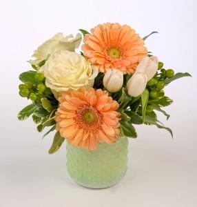 Peach gerbera, white roses in a mint glass hobnail jar
